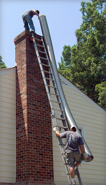 Cougots crew cleaning a chimney